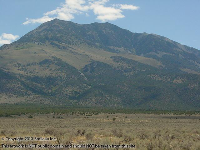 Beautiful Pilot Peak by Montello and Wendover Nevada in September 2003! At 10,716 feet she is the highest point in the Pilot Mountain Range and can be seen for miles across the valley! My Grandfather always told me I was related to the great American explorer Kit Carson and I read that Pilot Peak got its name from an expedition he was on! I just found an even greater reason to love it! Another place he explored before me! Char the Explorer : )