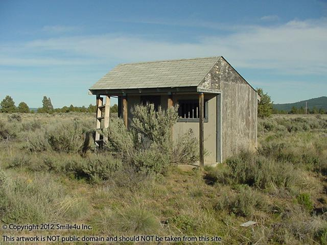 Mini saloon style cabin / shed that is on the property for sale in Nimrod River Park by Sprague River in Klamath County Oregon. Cute!