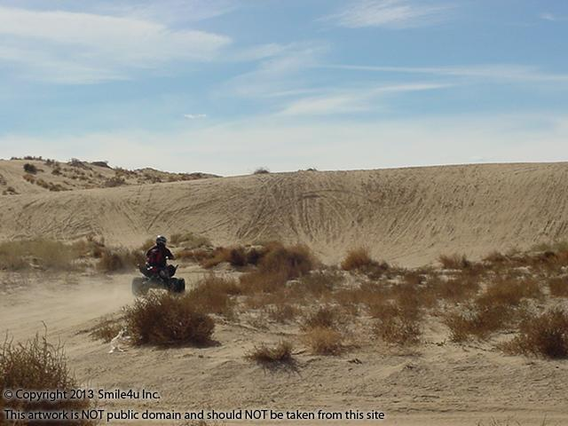 Someone out having fun on their quad in the sand dunes on the far west side of the Rio Rancho Estates by unit 3 just off Southern Boulevard and 60th Street in Sandoval County! This is just down the road from this property for sale. He put on a nice show for me! February 2013!
