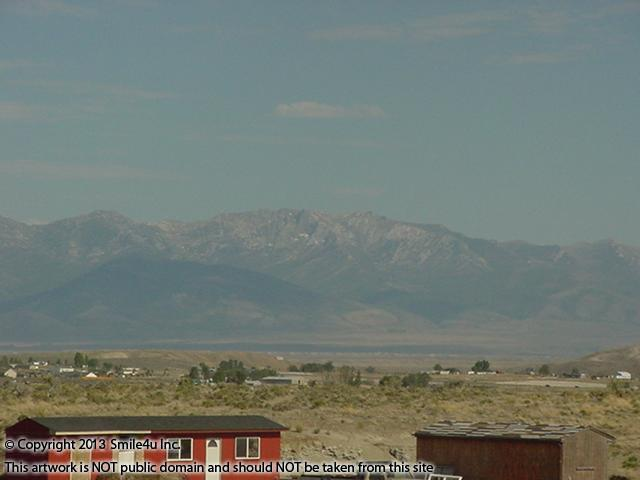 Fabulous views of the Ruby Mountains with Ruby Dome, the highest peak at 11,317 feet. The neighbors have a cute red house and barn set up a few lots away from this land for sale in Elko County, Nevada!