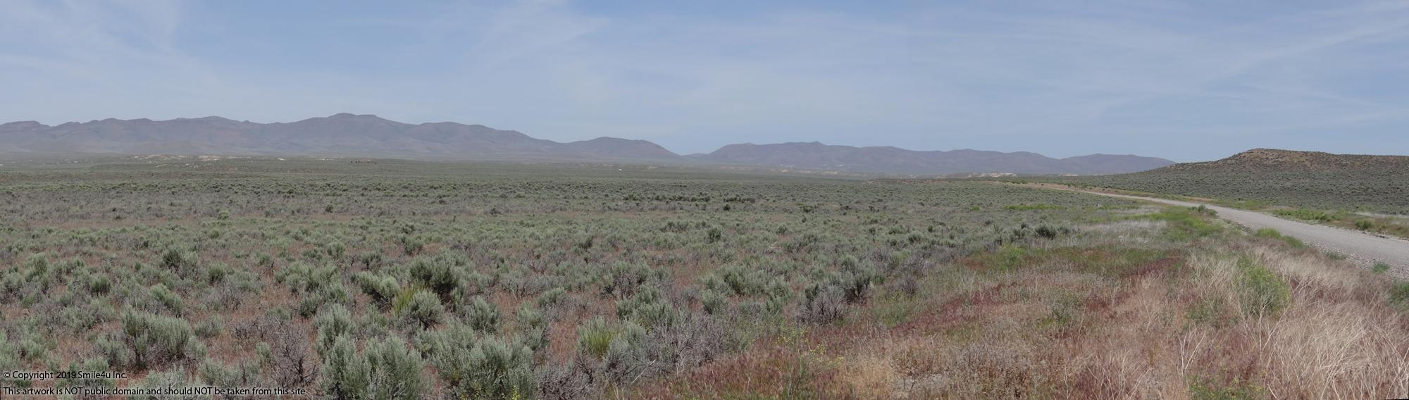Looking N across the lots with the Adobe Mountains surrounding the valley.